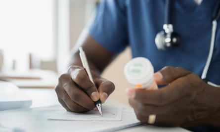 Close-up of doctor writing prescription