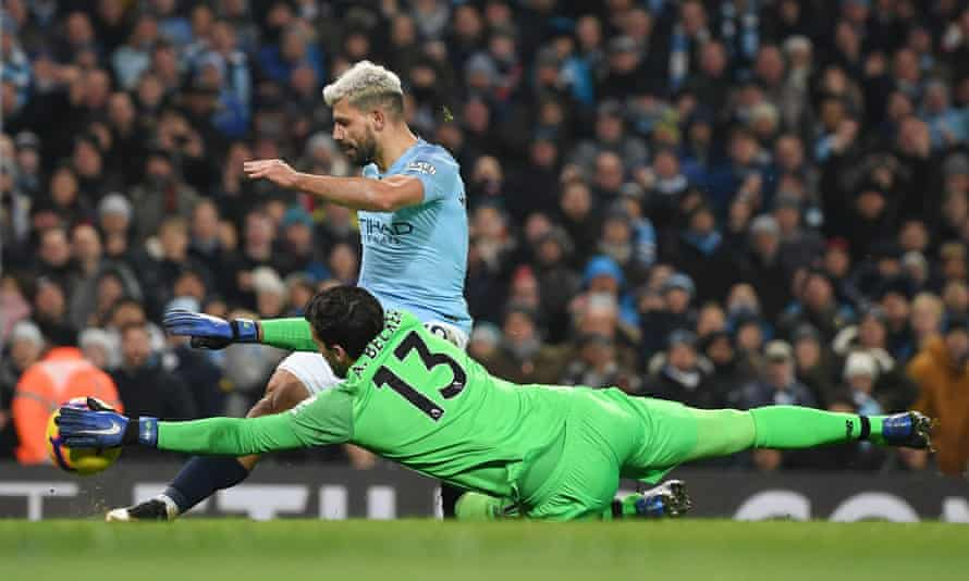 Alisson saves from Manchester City's Sergio Agüero in Liverpool's only league defeat of last season.