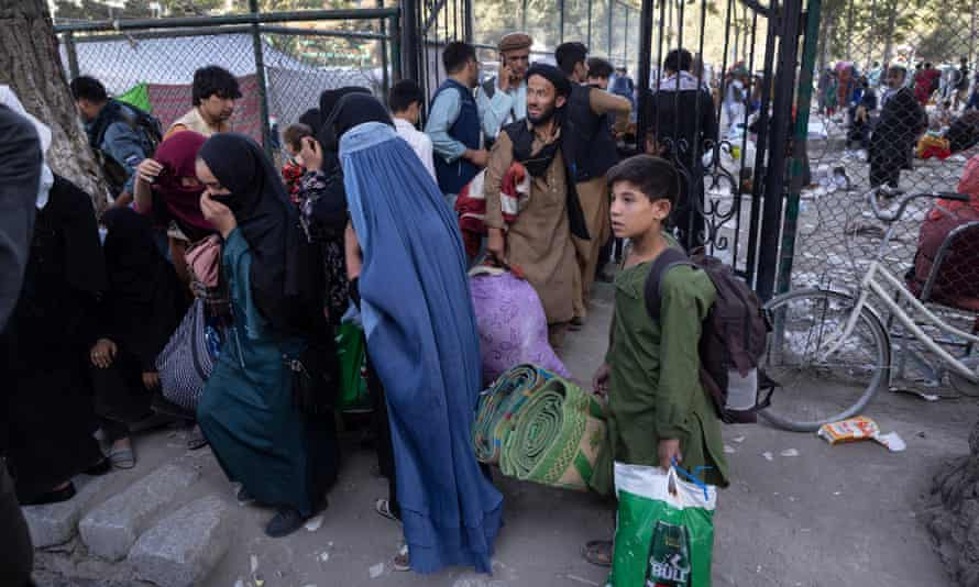 Displaced Afghans from northern provinces are evacuated from a makeshift camp to various mosques and schools in Kabul