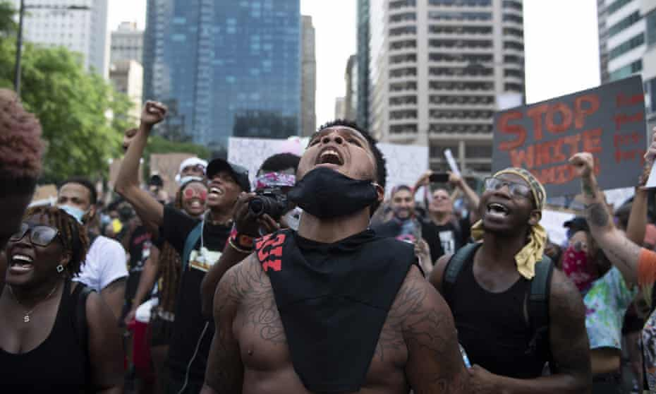 Christopher Bowman rallies demonstrators by City Hall in Philadelphia on Saturday.