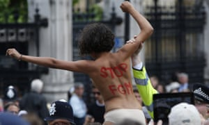 An activist protests against female genital mutilation opposite the Houses of Parliament in London.