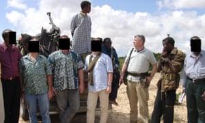 Paul Hopkins and hired gunmen protecting BAT management and local staff in Mogadishu, Somalia.