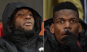 Manchester United's Romalu Lukaku and Paul Pogba watch proceedings from the bench.