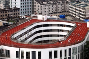 A  200-metre-long running track  built on the roof of a school in Tiantai county, China