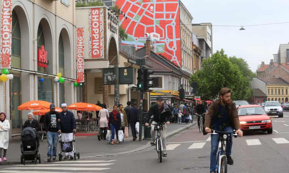 People walk at the street at Gronland district in Oslo, Norway