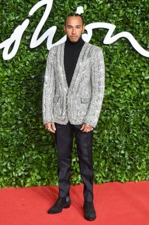 Lewis Hamilton arrives wearing a beaded blazer jacket
