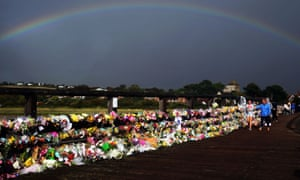 A rainbow over floral tributes at the Old Tollbridge near the A27 at Shoreham, after the Shoreham airshow crash.