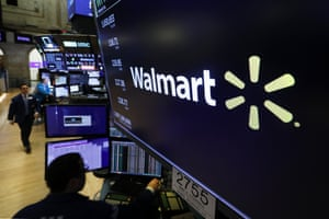 The logo of Walmart appears above a trading post on the floor of the New York Stock Exchange.