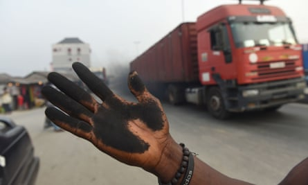 A resident's soot covered hand from wiping the bonnet of his car in Port Harcourt.