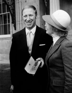 Jackie Charlton with his wife, after receiving his OBE, at Buckingham Palace in 1974.