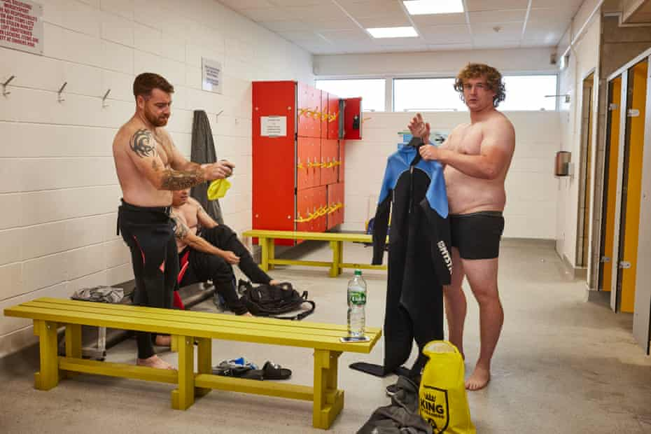 Steven Ferguson, 25 (right) gets into his wetsuit. 'Ste' as he his known to his friends, is a military veteran who served in the British armed forces for six years, enlisting as soon as he left school.