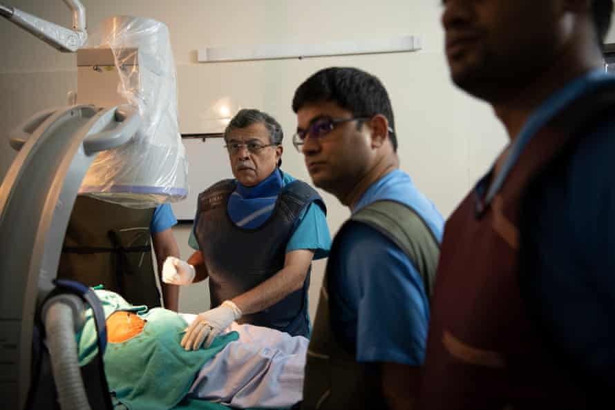 Dr GP Dureja performs a procedure on a patient in the operation theatre at the Delhi Pain Management Centre.