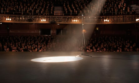 File photo of a spotlight shining on a theatre stage