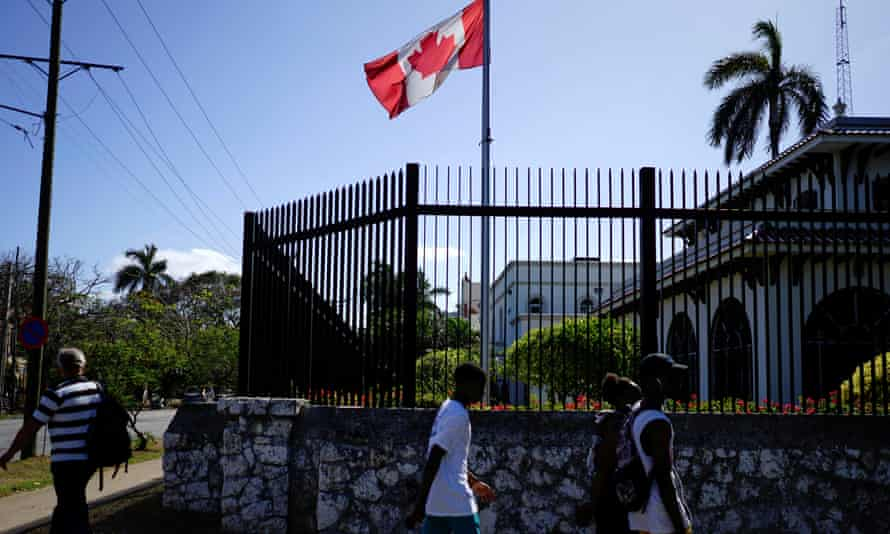 People pass by the Canadian embassy in Havana, Cuba, 16 April 2018.
