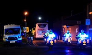 Buses carrying British nationals from the coronavirus-hit city of Wuhan in China, arrive at Arrowe Park Hospital in Wirral, Britain