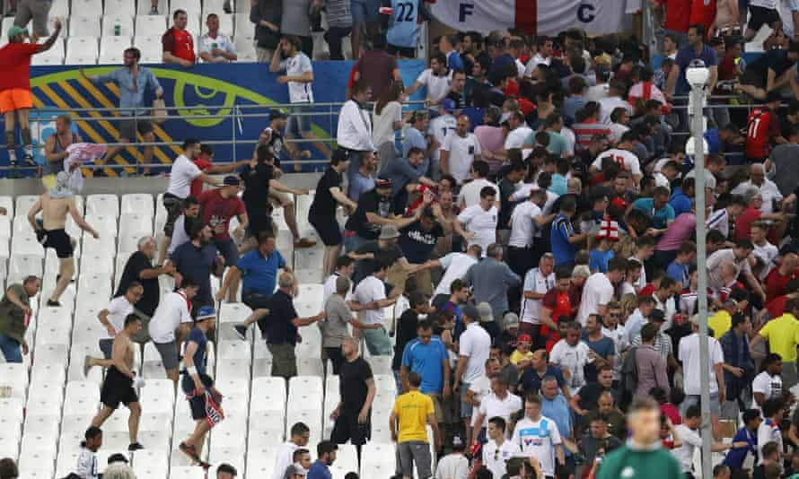 Fans clash in the stadium after the game between England and Russia in Marseille last summer.