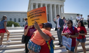 Demonstrators gather at the supreme court as the justices consider the census case.