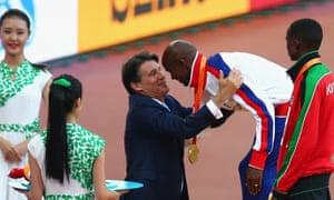 Sebastian Coe presents Mo Farah his 10,000m gold medal at the 2015 World Athletics Championships in Beijing.