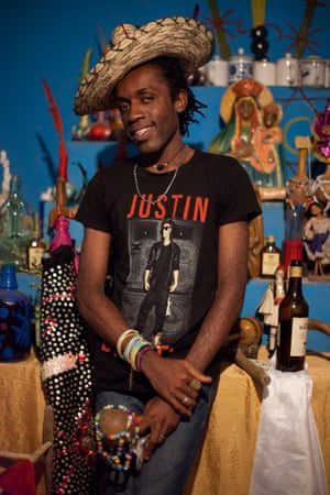 Ricardo Marie Dadoune, a 26-year-old gay hougan (Vodou priest) in the Port-au-Prince peristyle where he worships.