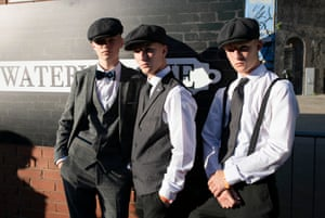 Three young fans of the show dress up in tribute during The Legitimate Peaky Blinders Festival in Birmingham