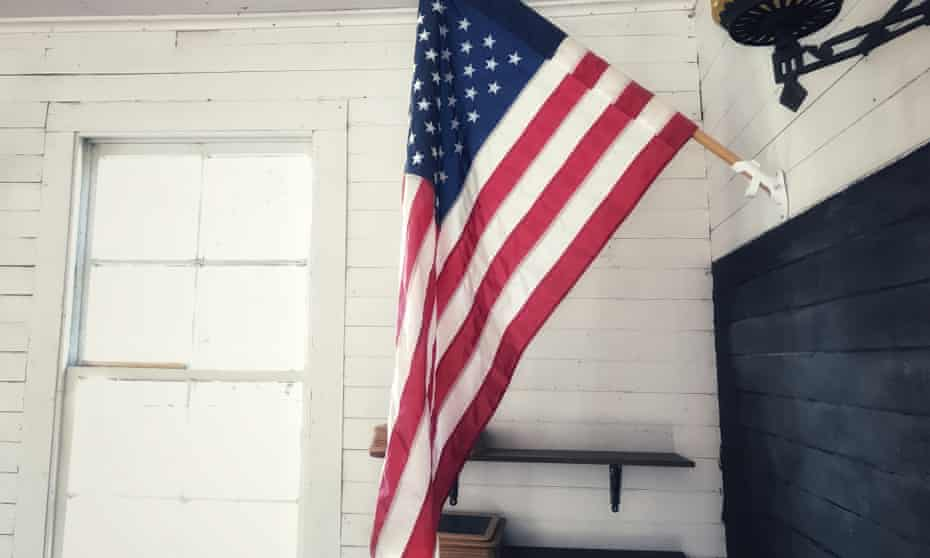 An American flag in a school house.