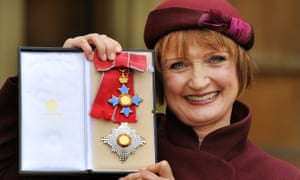 Tessa Jowell holds her Dame Commander insignia after it was presented to her by the Prince of Wales at Buckingham Palace in 2013