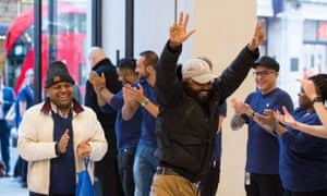 Two customers are clapped in to Apple's London flagship shop on the day the iPhone 8 is launched.