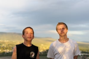 Vinny and David stand together before a summer storm in Raton, New Mexico