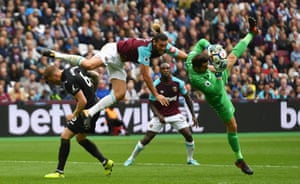 Swansea's keeper Lukasz Fabianski collides with West Ham's Andy Carroll as The Hammers beat The Swans 1-0 at the London Stadium.