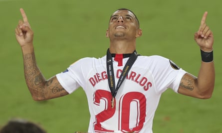 Diego Carlos celebrates Sevilla's Europa League final victory over Internazionale in August