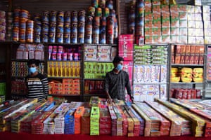 Firecracker vendors wait for customers at a market ahead of Diwali, the Hindu festival of lights, Allahabad , India