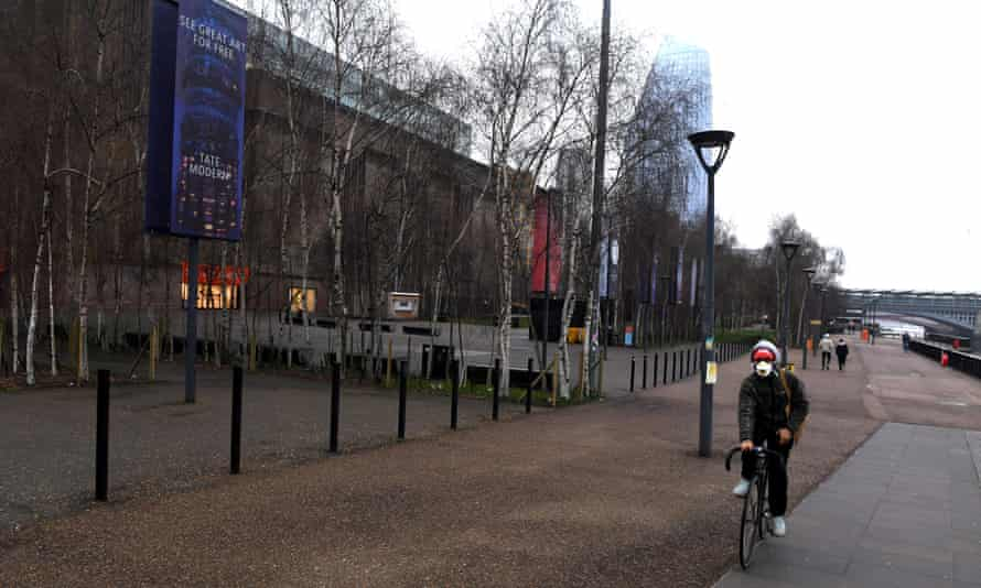 South Bank outside the Tate Modern gallery with one cyclist going past