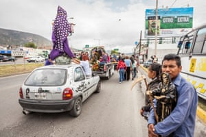 Santa Muerte Devotees line the street for a Santa Muerte procession, in Pachuca, Hidalgo State, Mexico.