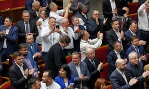 Lawmakers clap and smile in Ukraine's parliament