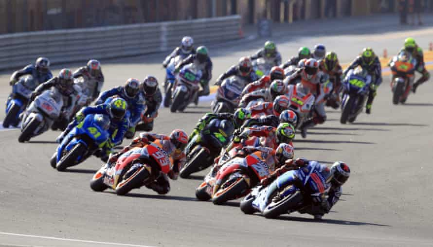 Jorge Lorenzo leads into a corner as Valentino Rossi (second right) attempts to scythe through the field.