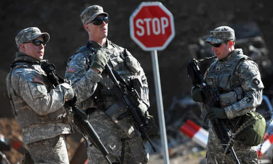 KFOR soldiers stand guard at Jarinje border crossing between Serbia and Kosovo.