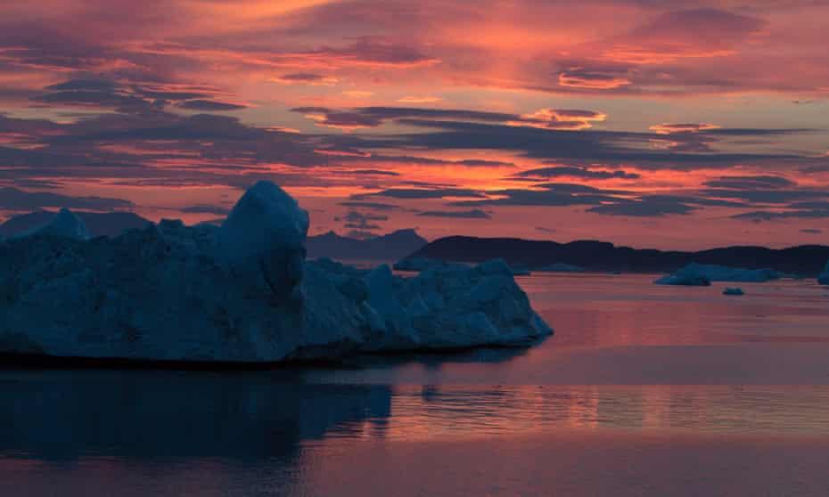 Sun sets over the glacier Zachariae Isstrom