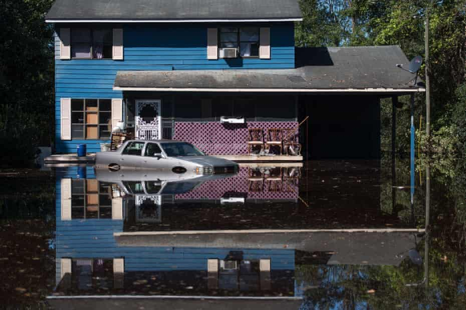 A residence is inundated with floodwaters from the Lumber River i 2016 in Fair Bluff, North Carolina.