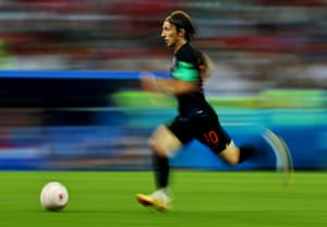 Luka Modric runs with the ball against Russia in the quarter-finals. The Croatian captain was named player of the tournament as he led his team to the final.