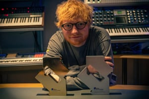 Ed Sheeran with his awards for his No 1 single and album.