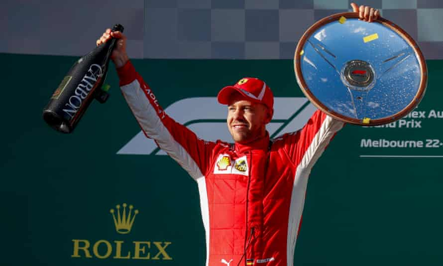 German Formula One driver Sebastian Vettel of Ferrari celebrates winning the 2018 Formula One Grand Prix of Australia at the Albert Park circuit in Melbourne.