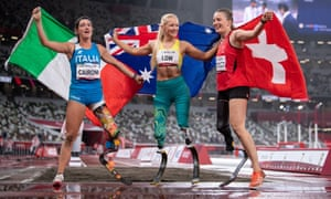 Gold medalist Vanessa Low of Australia celebrates with silver medallist Martina Caironi and bronze medallist Elena Kratter after the Long Jump - T42 Final.