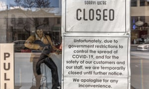 A closed due to Covid-19 restrictions sign is seen at the front of a restaurant on Chapel Street in Melbourne.