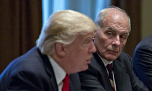 John Kelly, White House chief of staff, listens as U.S. President Donald Trump, left, speaks during a briefing with senior military leaders in the Cabinet Room of the White House in Washington, D.C. on October 5, 2017.