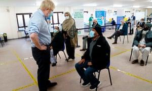 Boris Johnson at the Al-Hikmah vaccination centre in Batley.