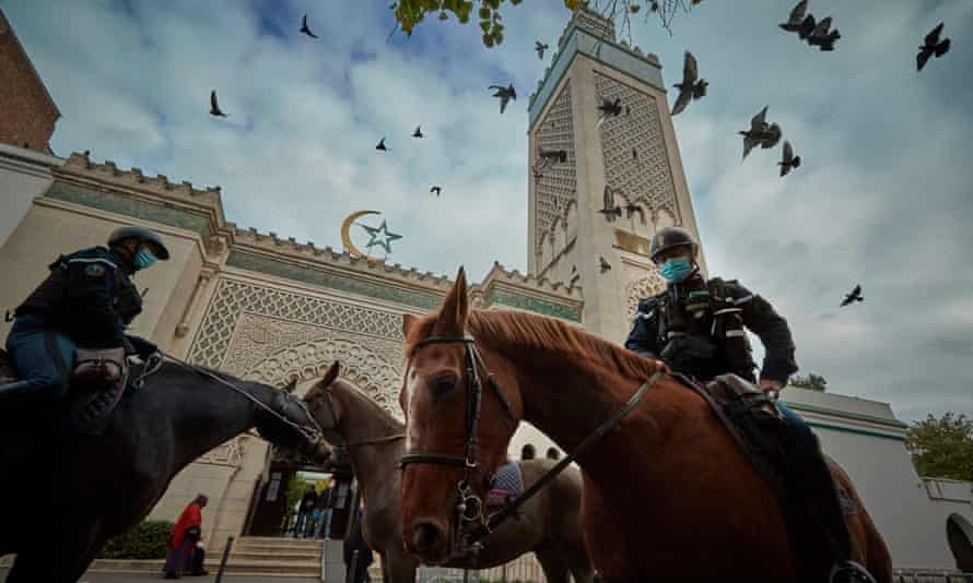 Mounted police patrol guard the Grand Mosque in Paris during prayers last Friday.