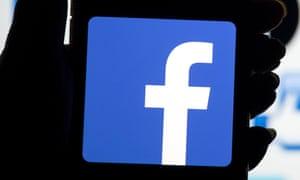 The Facebook logo on a phone screen