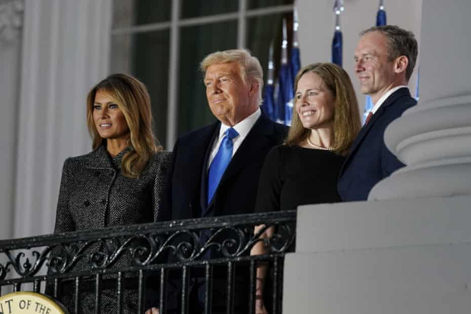 Melania Trump, Donald Trump, Amy Coney Barrett and Jesse Barrett stand on the balcony following the swearing-in ceremony.