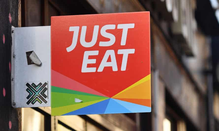 A sign for Just Eat above a restaurant in London