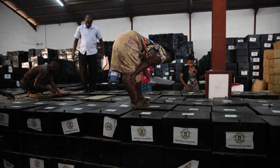 Volunteers check ballot boxes in Kampala